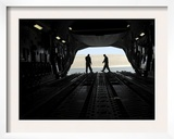 C-17A Globemaster Iii Loadmasters Go Through Prefight Checks on the Ramp