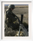 A Soldier Changes the Barrel of an M2 50 Caliber Machine Gun