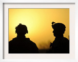US Army Soldiers Silhouetted Against the Morning Sun in Afghanistan