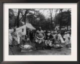 Three Sumo Wrestlers Posed Outdoors with Spectators in Background  Probably in Japan  1905