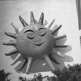 Sun With Human Face on Building Wall