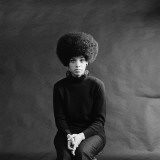 Young African-American Woman With Afro  Looking Sad