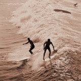 Men Surfing Waves