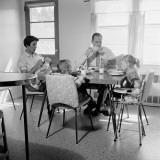 Family of Five Eating Breakfast at Kitchen Table