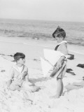 Two Boys Wearing Sailor Suits on Beach  One Holding Toy Sailboat
