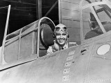 Smiling WWII Navy Pilot Sitting in Cockpit