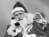Santa Claus on the Telephone With His Sack of Toys on His Back