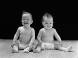 Twin Babies Sitting Wearing Diapers  Laughing and Smiling