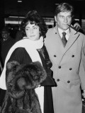 Elizabeth Taylor and Husband John Warner at Heathrow Airport  December 1976