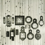 Display of Clocks Collection on Pine Wall