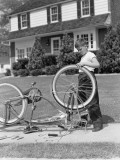 Boy Outside Front of House  Bicycle Upside Down  Spinning Front Wheel