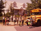 Elementary School Students Crossing Street in Front of School Bus