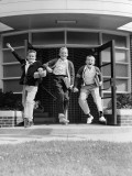 Three Excited Boys Running Out of School