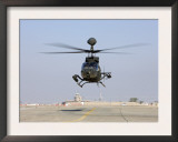 An Oh-58D Kiowa Warrior Hovers over the Flight Line at Camp Speicher  Iraq