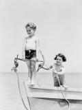 Boy Standing on Bow of Row Boat Holding Anchor  Girl Holding Rope