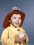 Boy in Fireman Costume Holding Glass of Milk