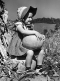 Girl Sitting on Pumpkin  Wearing Sun Bonnet