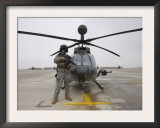 An Oh-58D Kiowa Warrior Pilot Stands Beside His Aircraft