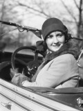 Woman in Convertible Car Wearing Cloche Hat
