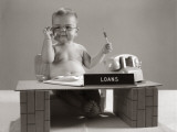Baby at Desk Playing Loan Officer
