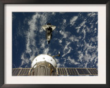 Space Shuttle Endeavour and a Soyuz Spacecraft