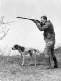Upland Bird Hunter With Pointer Dog  Taking Aim