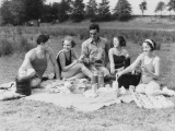 Group of Five People Having Summer Picnic on Beach