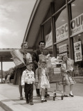 Family Carrying Groceries Home