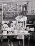 Mother and Daughter at Kitchen Table  Preparing Ingredients in Mixer For Baking