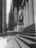 Statue at Steps in Front of Building  Wall Street  Trinity Church in Distance  New York City