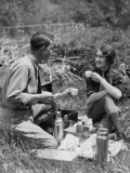 Couple Sitting in Grass  Having Picnic