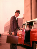 Salesman With Attache Case About To Enter Taxi Cab
