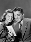 Smiling Couple Looking at Insurance Policy Brochure