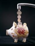 Money Pouring Into Piggy Bank