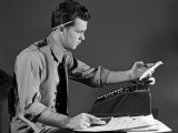 Man in Office at Adding Machine