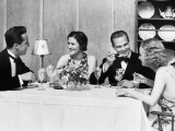 Two Couples Wearing Formal Dress  Sitting at Table Eating and Talking