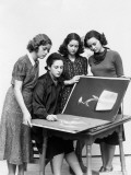 Three Young Women Observing As Fourth Sketches