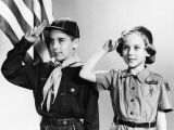 Boy and Girl Scouts Saluting  American Flag in Background