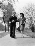 Couple Walking Outdoors  Man Wearing Sailor Uniform  Woman Wearing Coat  Hat and Gloves