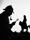 Silhouette of Man Wearing Deerstalker  Dressed As Sherlock Holmes