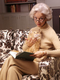Woman Reading Book  Holding Orange Tabby Cat