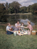 Retro Family Sitting Together Enjoying Picnic Food