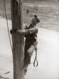 Utility Worker Man is Climbing Electric Power Utilities Pole