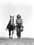 Woman Walking Beside Horse Holding Cowboy Hat in Gloved Hand