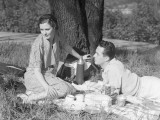 Couple Under Tree Having Picnic