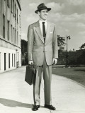 Man in Full Suit Standing on Sidewalk  (Portrait)