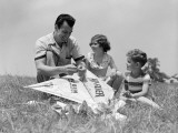 Father Flying Kite With Children