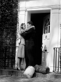 Sailor With Duffel Bags  Hugging Woman  About To Kiss on Front Doorstep