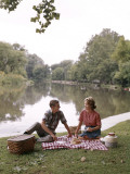 Retro Couple Having a Picnic By the Water
