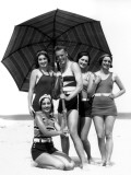Four Women and One Man Under Beach Umbrella in Bathing Suits
